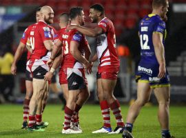 Salford Red Devils' Kallum Watkins (centre right) celebrates after the final whistle during the Coral Challenge Cup, Semi Final at The Totally Wicked Stadium, St Helens.