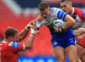 Leeds Rhinos' Ash Handley (right) is tackled by Salford Red Devils Lee Mossop during the Coral Challenge Cup Final at Wembley Stadium, London. Image credit: PA Images