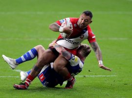 Salford Red Devils' Krisnan Inu is tackled by St Helens' Tom Nisbet during the Betfred Super League match at the Emerald Headingley Stadium, Leeds.