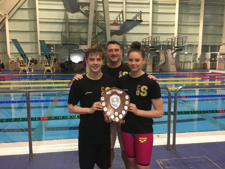 John with two of his swimmers, holding the trophy for Lancashire Top Club, which City of Salford Swimming Club won earlier this year