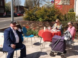 Critchley regulars enjoy food and drink in the sun together.