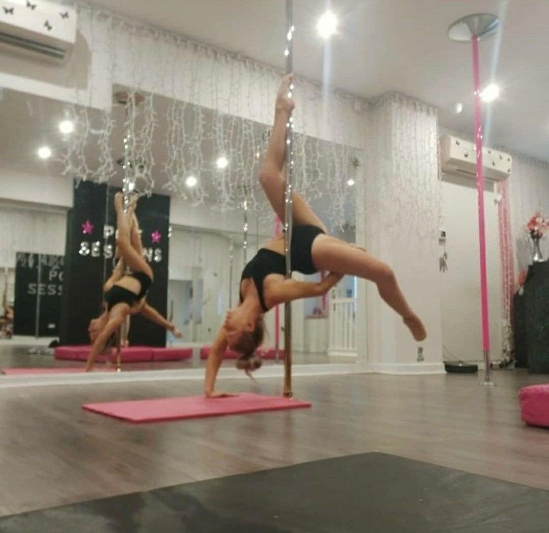 Becky performing as part of pole fitness. Permission to use the image from Becky Kelly.