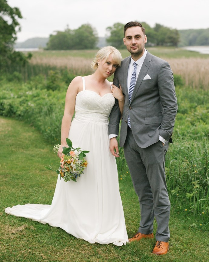 Serious photo of bride and groom in a natural setting in Maine