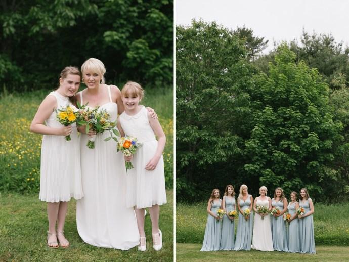 Bride, flower girls, and bridesmaids hold wildflower bouquets