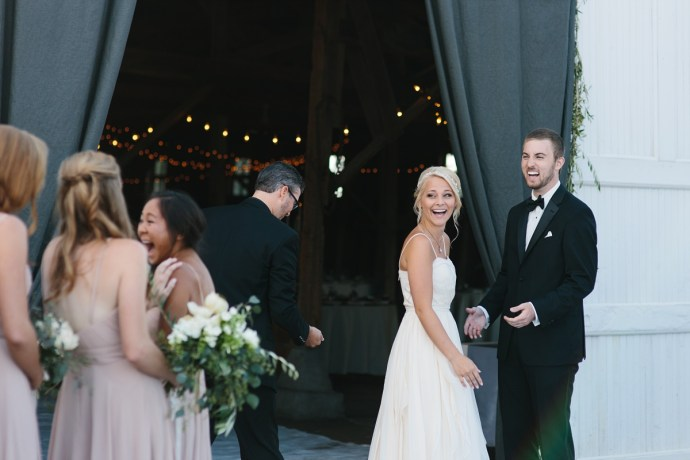 Bride and groom looking happy at ceremony