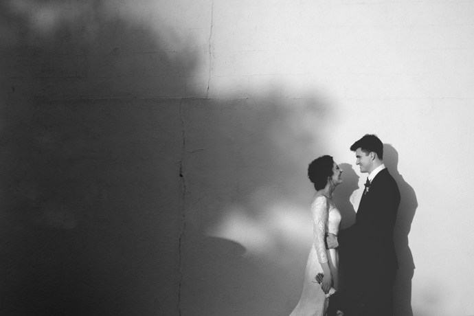 artistic photo of bride and groom in the shadows