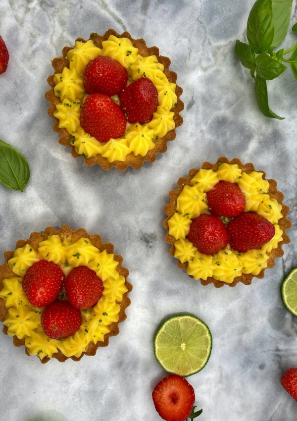 Impress your guests with delicious Strawberry tarts with lime and basil cream