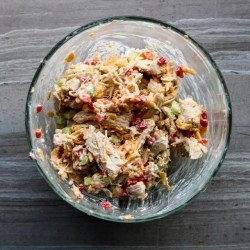 Image of a glass bowl on a grey counter top. The bowl is filled with Pimento Cheese Chicken Salad