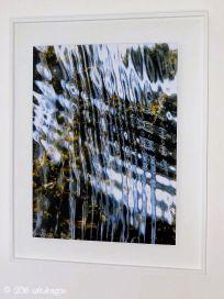 artwork framed in white tulipwood