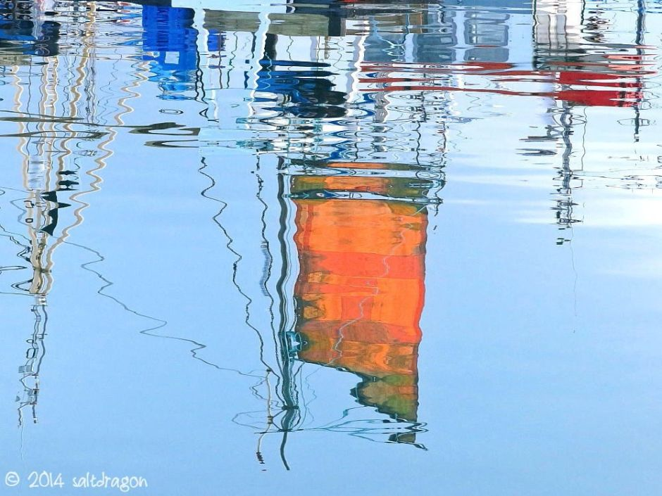 orange sail reflections at Newlyn harbour in Cornwall