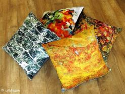 pile of cushions with different designs