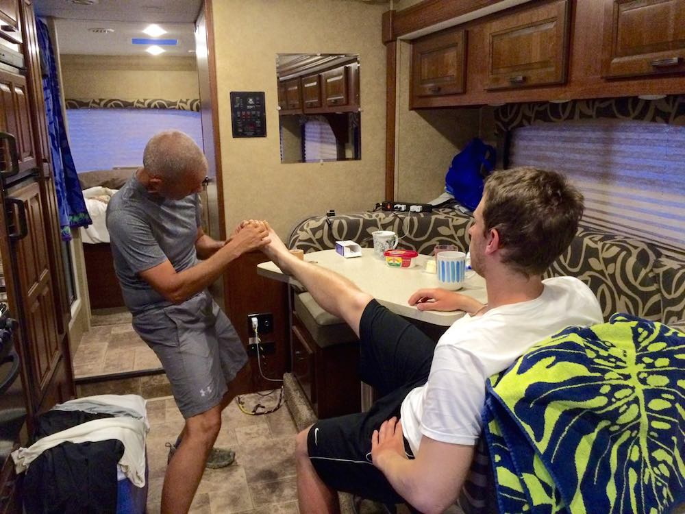 Randy Brown tending to Blake Alexander's feet