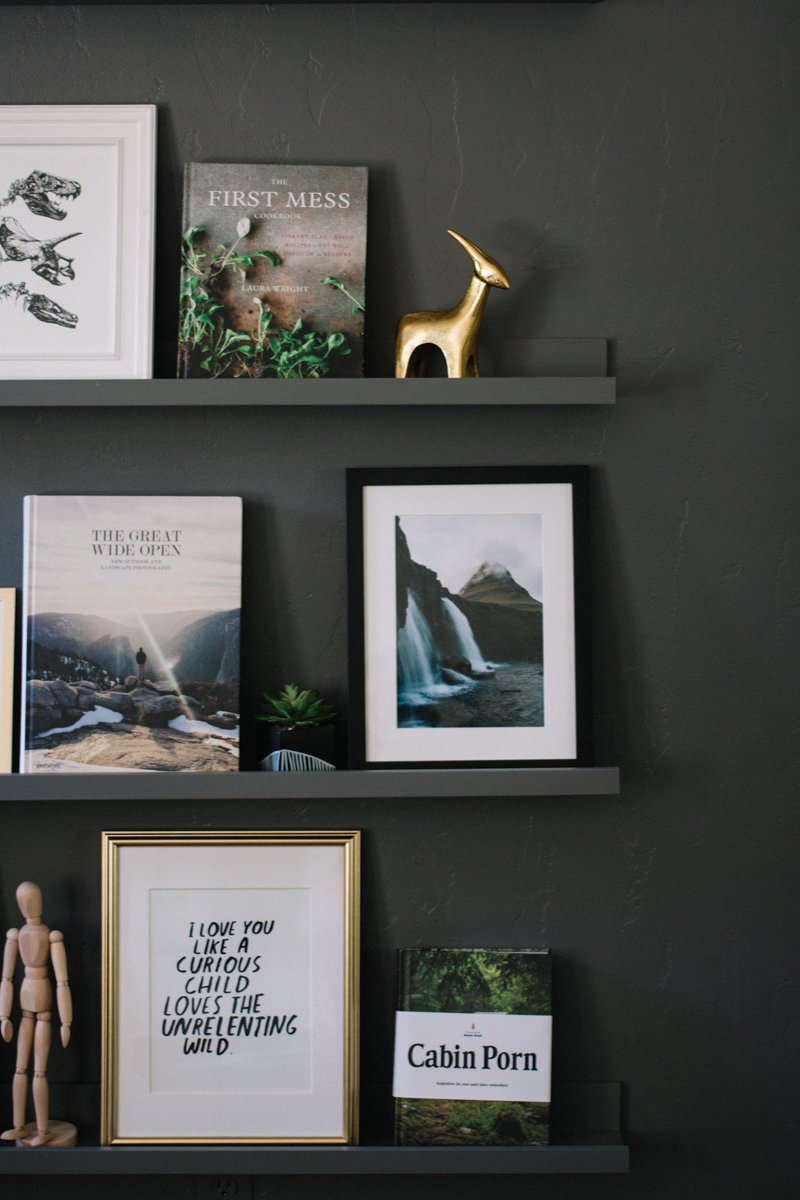 Minimalist, adventure themed shelf gallery wall | saltyspaces.com