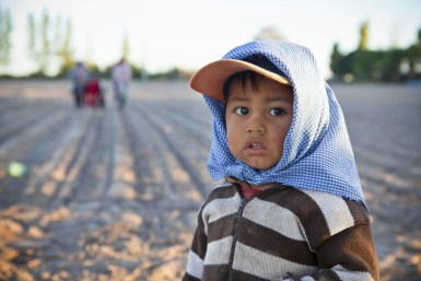 Latino farm boy in poverty and food insecurity