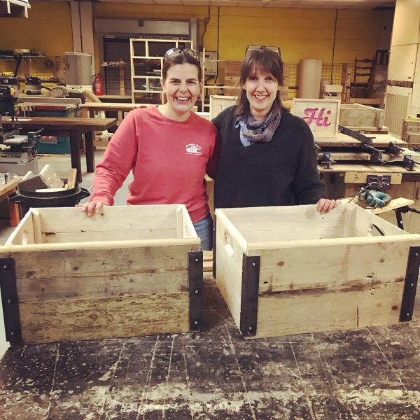Happy students have finished their industrial boxes