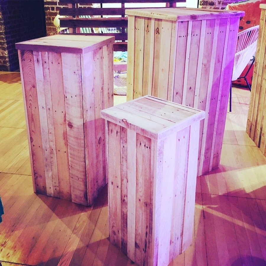A trio of display plinths made from pallets that fit inside each other