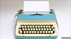 Typewriter with a blank page