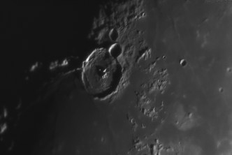 Gassendi has a diameter of 110km and is 1.9km deep. In the image the system of rilles on the crater floor is visible.