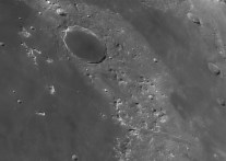 Plato is the flat floored crater in the top of the image, to the right, a rille, the rima Plato is visible. To the lower right the Alpine Valley cuts through the Montes Alpes.