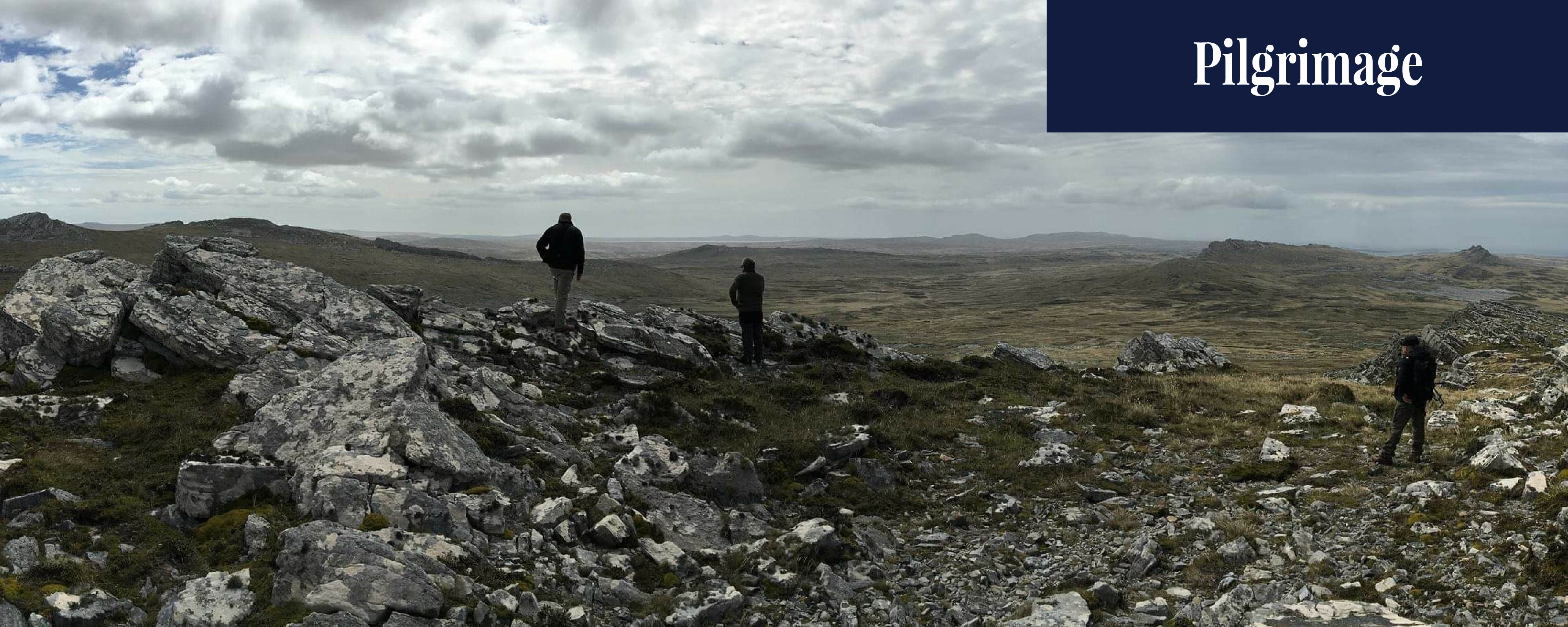 Photogtraph taken by T McHugh of J McLachlan and M Weatherley from Mount Harriet, Falkland Islands. J McLachlan and M Weatherley in foreground.