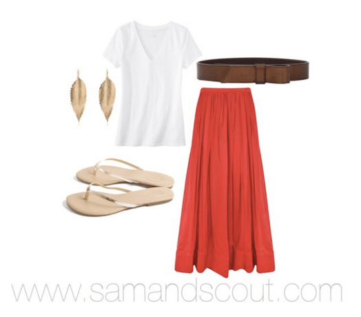 White tee with pleated maxi, leather belt, and gold accessories