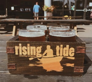 Flight of beer in square wooden box at Rising Tide Brewing Company in Portland