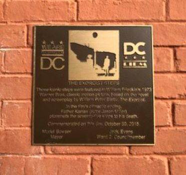 Plaque on wall describing the exorcist steps in Georgetown, DC