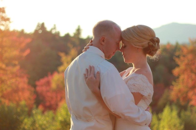 Lindsay and Josh on their wedding day with a view of the mountain in the background