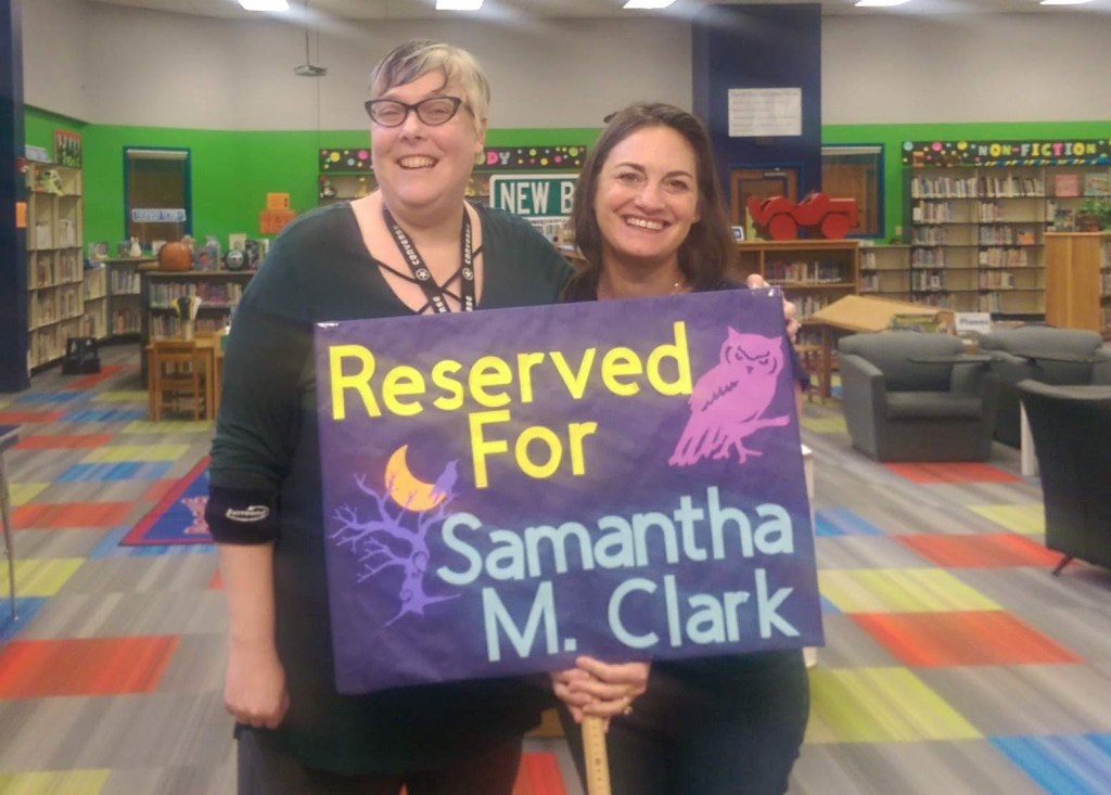Boone Elementary librarian Michelle Lightbourne had a parking spot reserved for Samantha M Clark with this wonderful sign.
