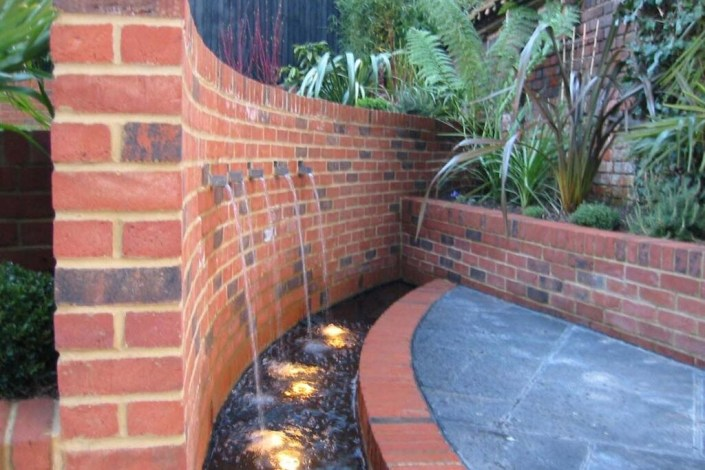 Garden pond with lighting by Sam Coles Lighting