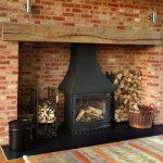 Fireplace lighting with wooden beams by Sam Coles Lighting