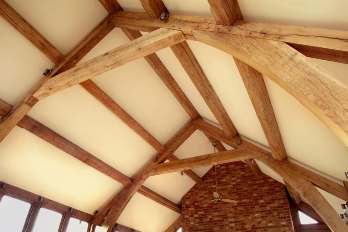 Roof lighting with wooden beams by Sam Coles Lighting
