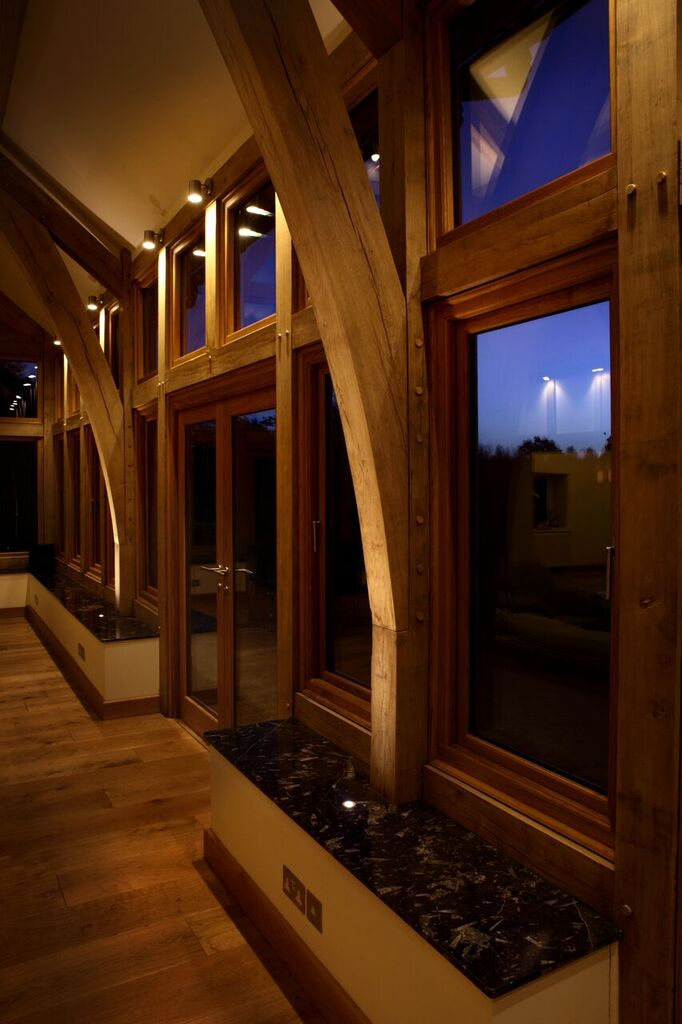 Lounge lighting with wooden beams by Sam Coles Lighting