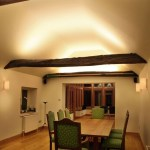 Diningroom lighting with beams by Sam Coles Lighting