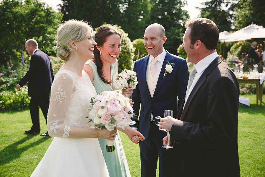 bride and groom laughing at barnsley house by sam gibson