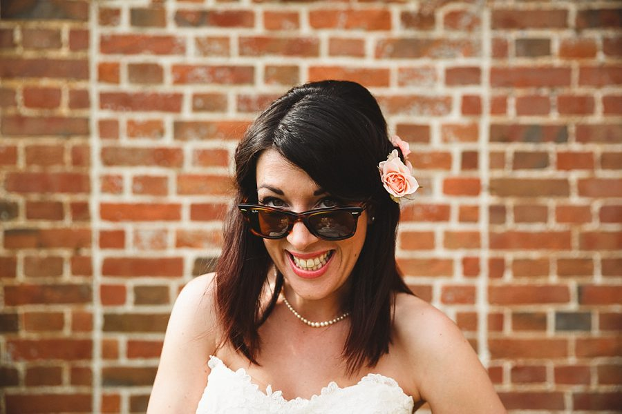 a bride in sunglasses at crowcombe court by sam gibson