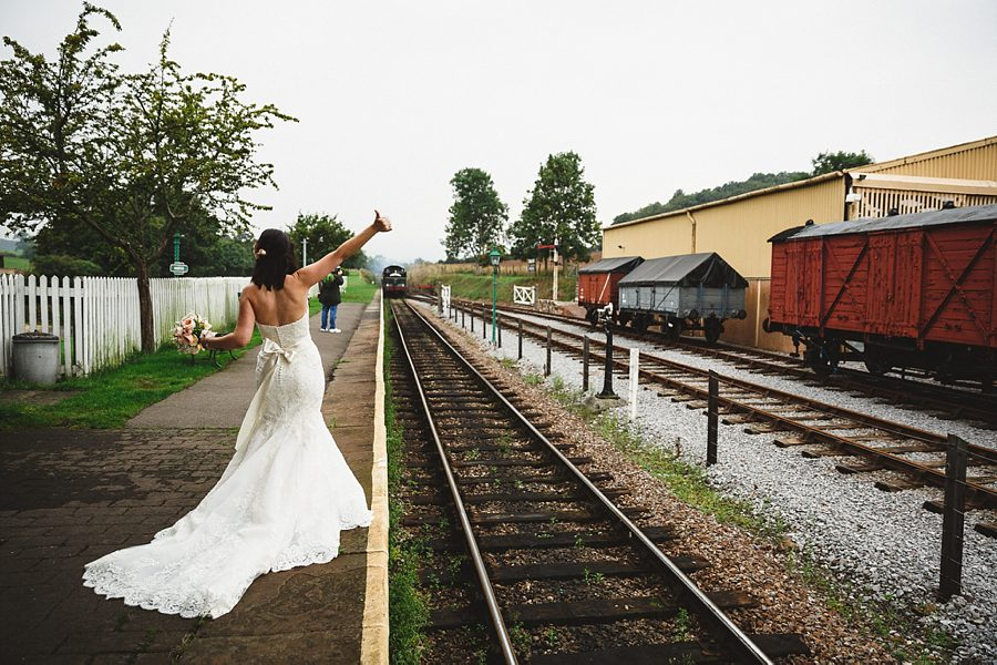 a bride waits for a steam train by sam gibson