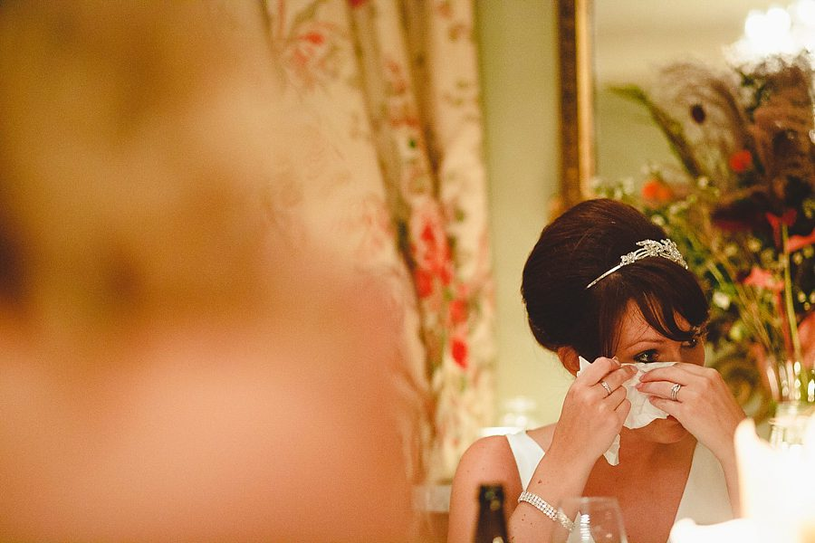 bride wipes tear from her eye at charlton house hotel wedding