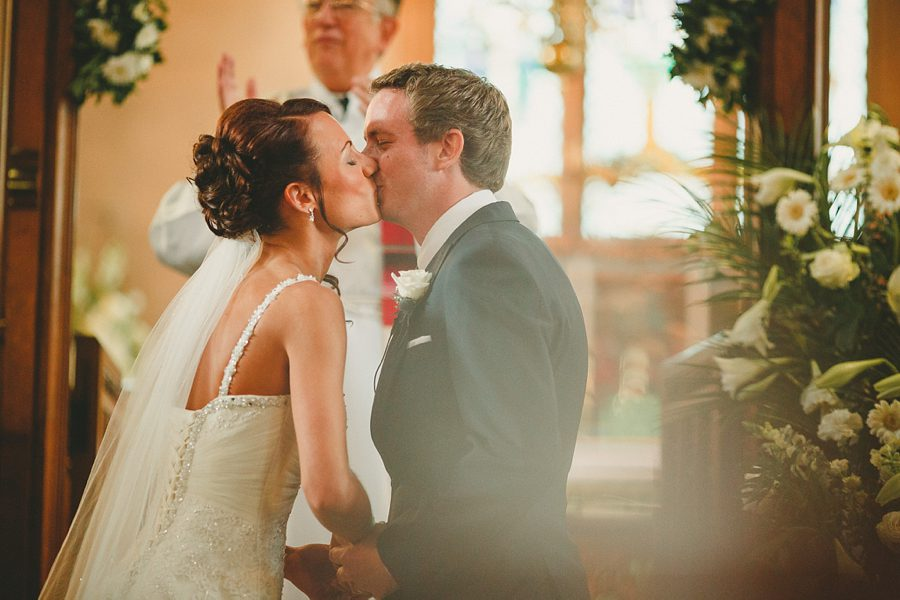 bride and groom first kiss at kelmarsh hall