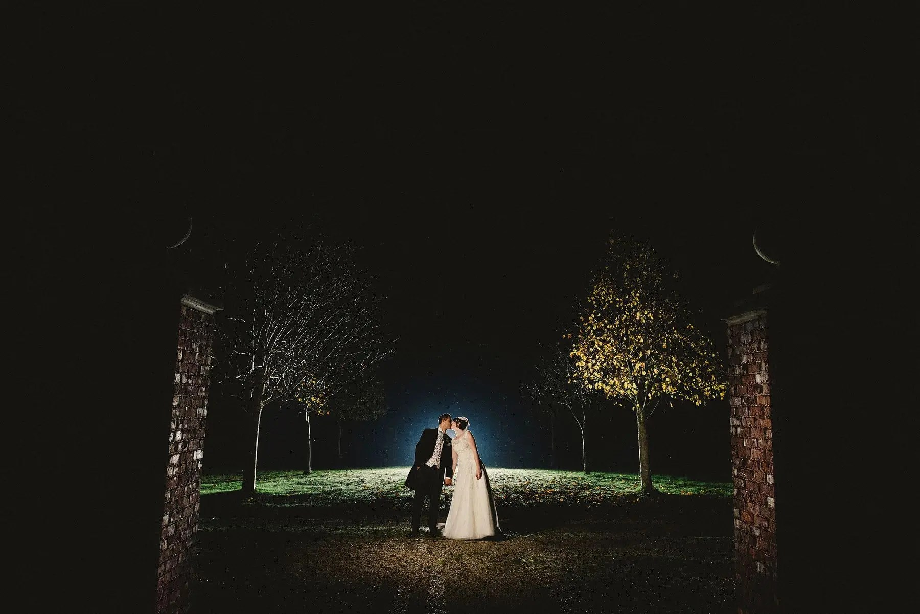night portrait of bride and groom at kingston estate