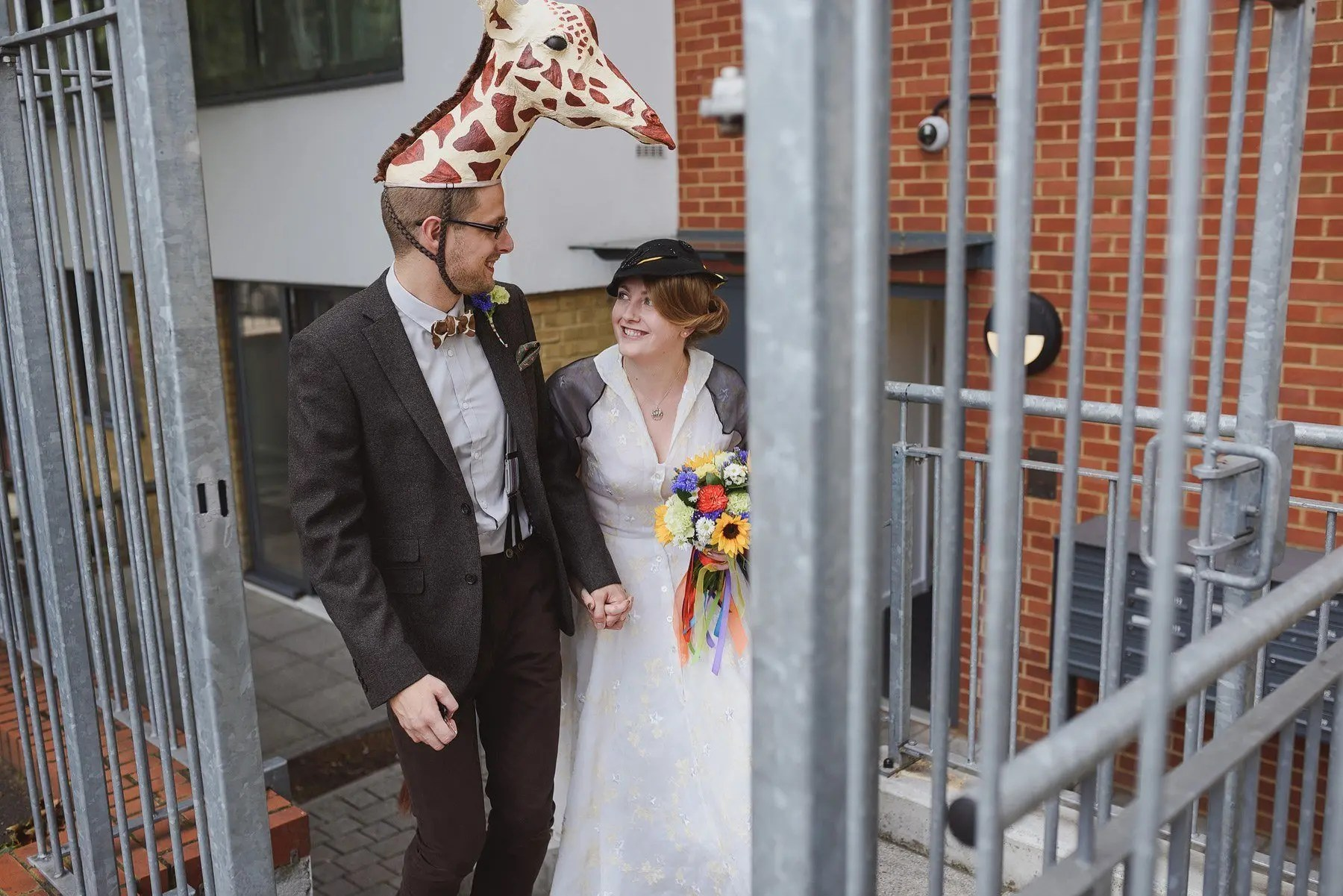 bride and groom leaving for their wedding in fancy dress