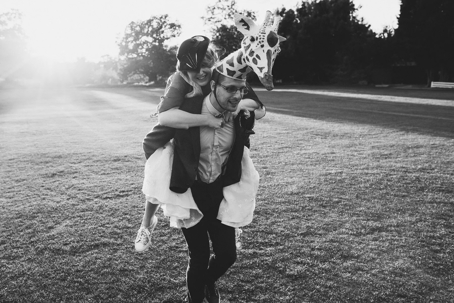 groom gives bride a piggy back
