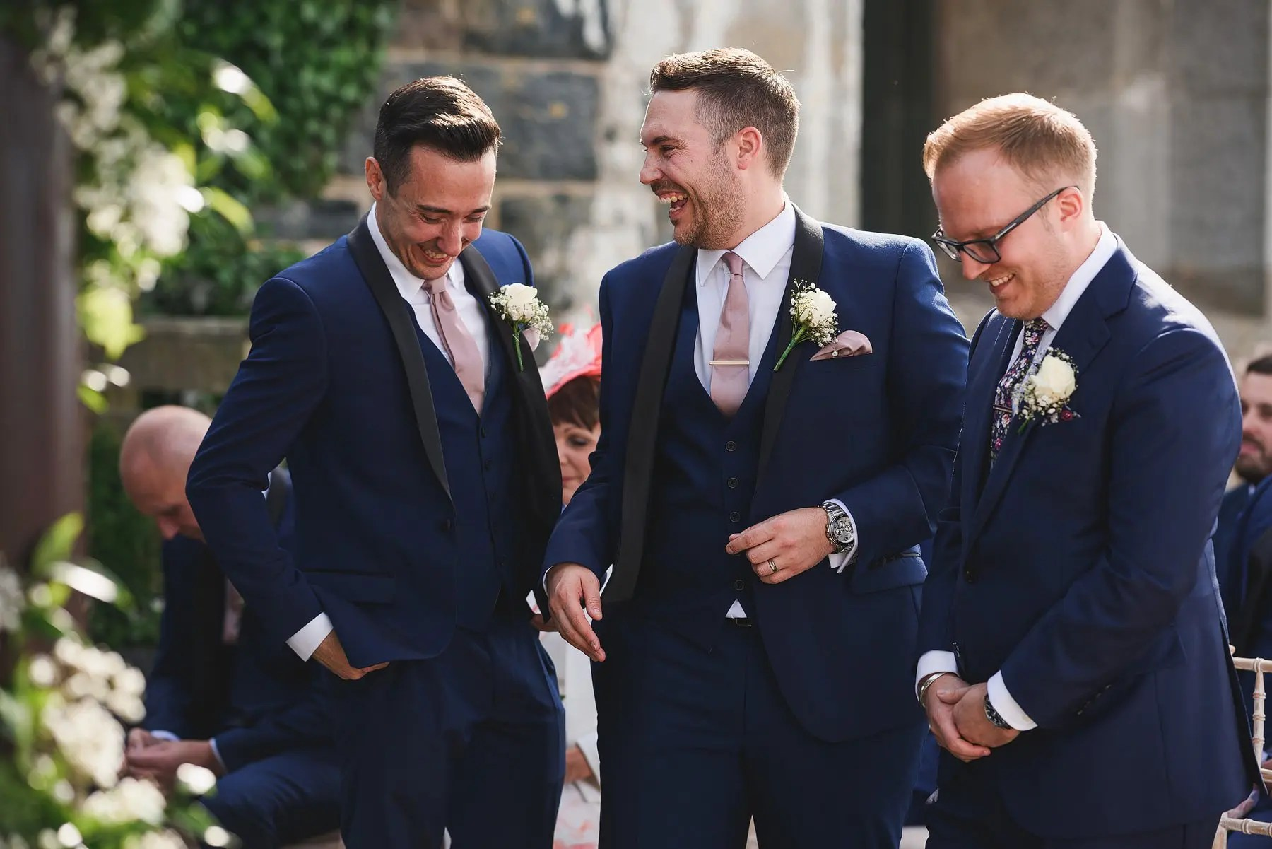 groomsmen laughing before the wedding ceremony
