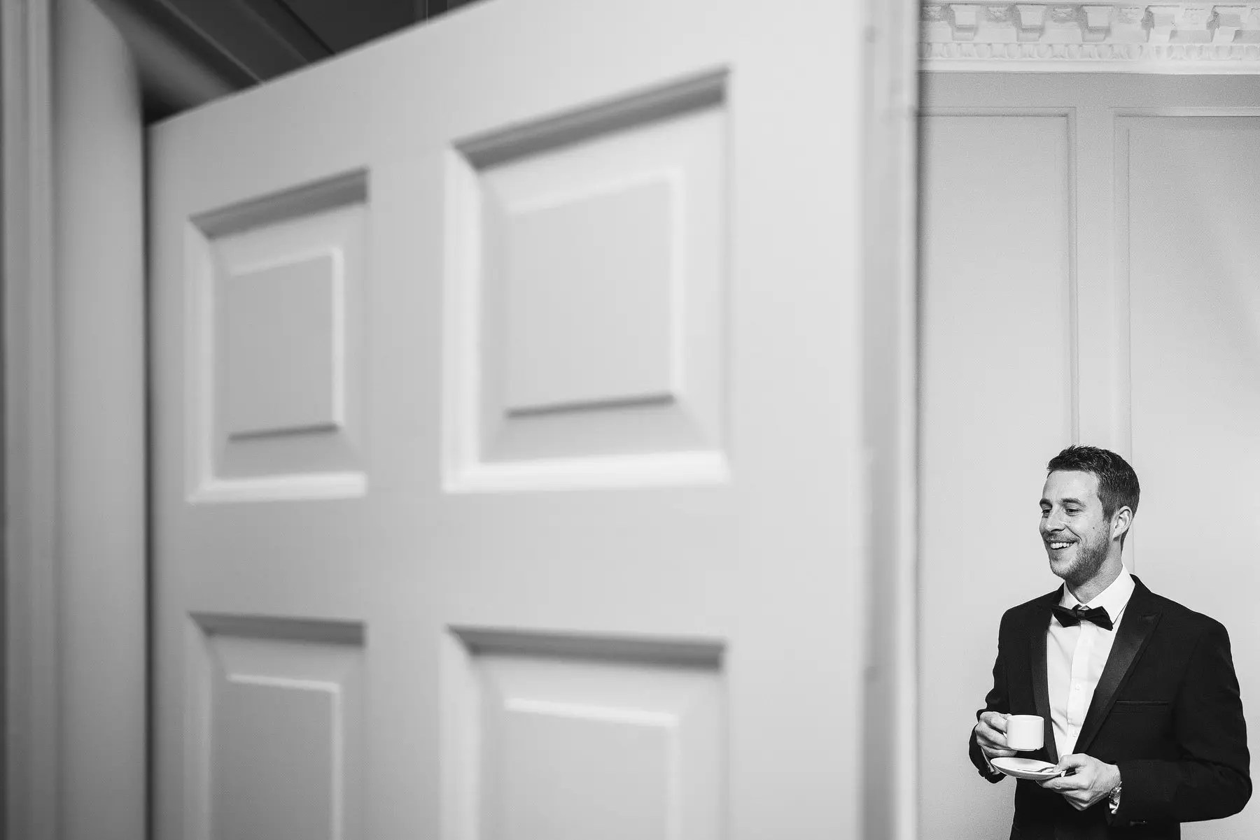 man drinking coffee at a wedding