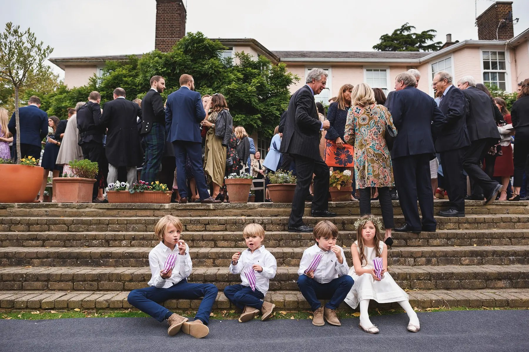 kids eating sweets at a wedding