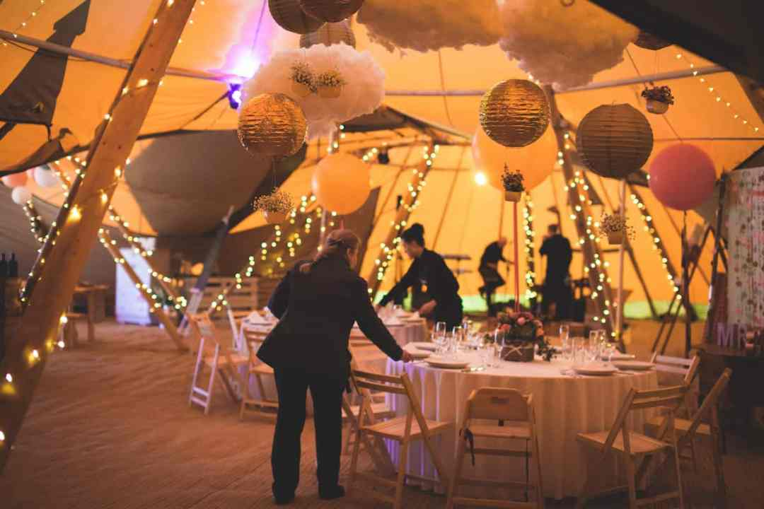 Setting up the tipis - Sami Tipi Starlight Social captured by Christopher Terry
