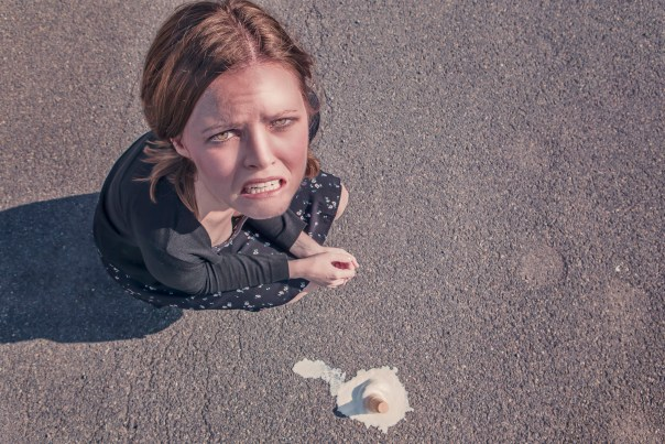 woman spilled ice cream cone