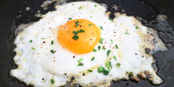 The Love Song Of The Burnt Orange Egg Pan