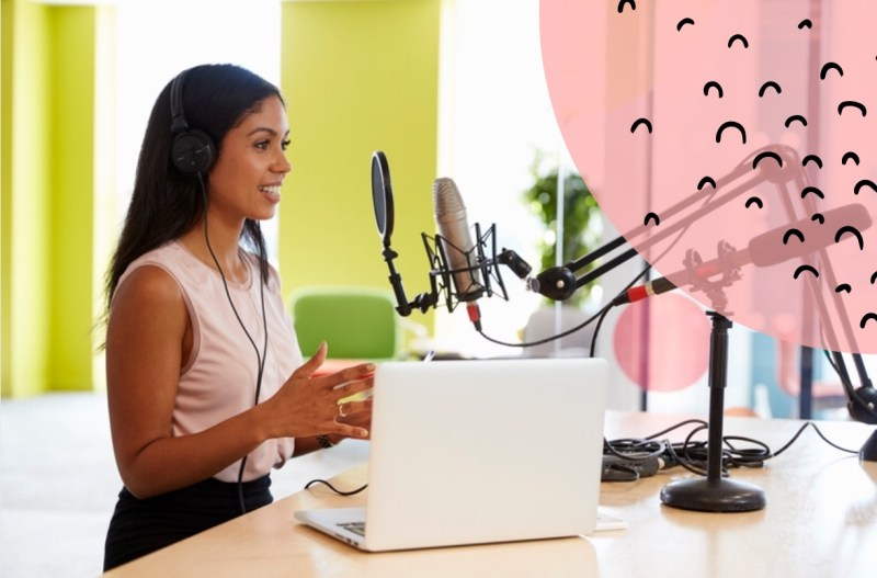 Female podcaster speaking into microphone in front of laptop