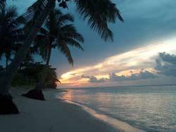 Tan Beach Fales Sunset